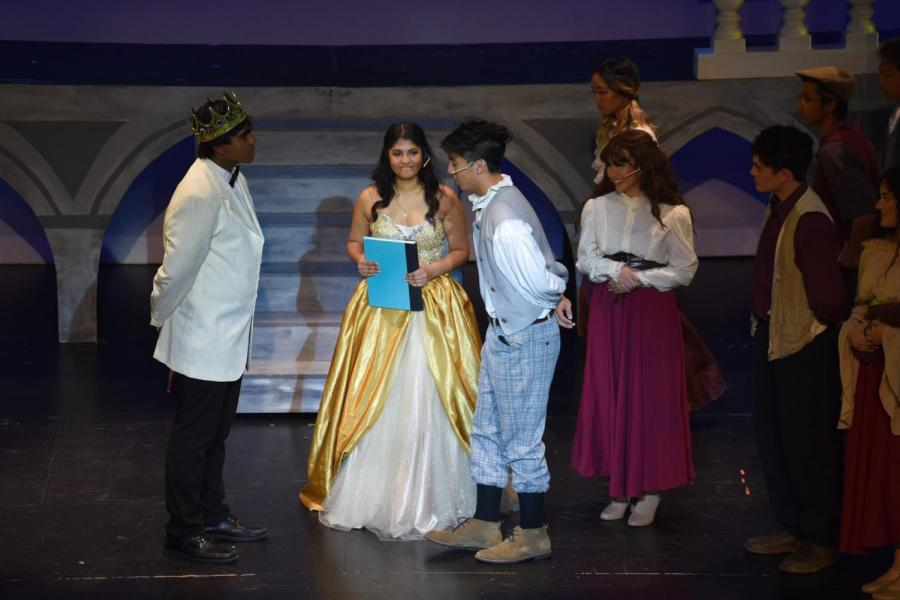 The cast of Cinderella practice their lines during after school rehearsals while sharing a fun moment. Despite the long and oftentimes stressful hours, the actors work together and stay committed to perfect their performance.