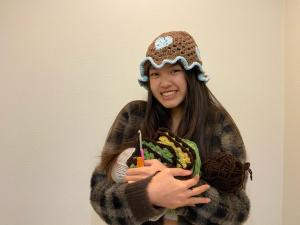"""Freshman Belan Ngo's crochet designs are heavily inspired by fashion trends she sees on social media platforms, whether it be TikTok, Pinterest or Instagram. """"I saw videos on TikTok, actually. There was this one girl who was making a heart crochet hat, and I couldn't find a tutorial on YouTube, so she helped me with it and sent me different videos to learn off of,"""" Ngo said. """"I also check people's Instagrams and see what's most popular at the moment and see if I can turn it into a crochet item."""""""