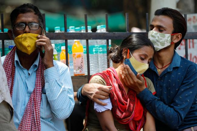 Relatives who lost a family member due to the Coronavirus surge are outside Lok Nayak Jai Prakash Narayan hospital in New Delhi on April 21, according to the Associated Press. New Delhi has become a major hotspot during the surge.