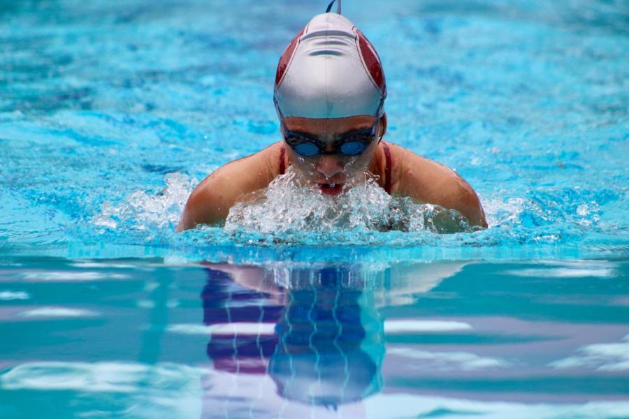 Senior Allison Kramer swims the breaststroke at a summer Irvine Swim League meet in 2019.