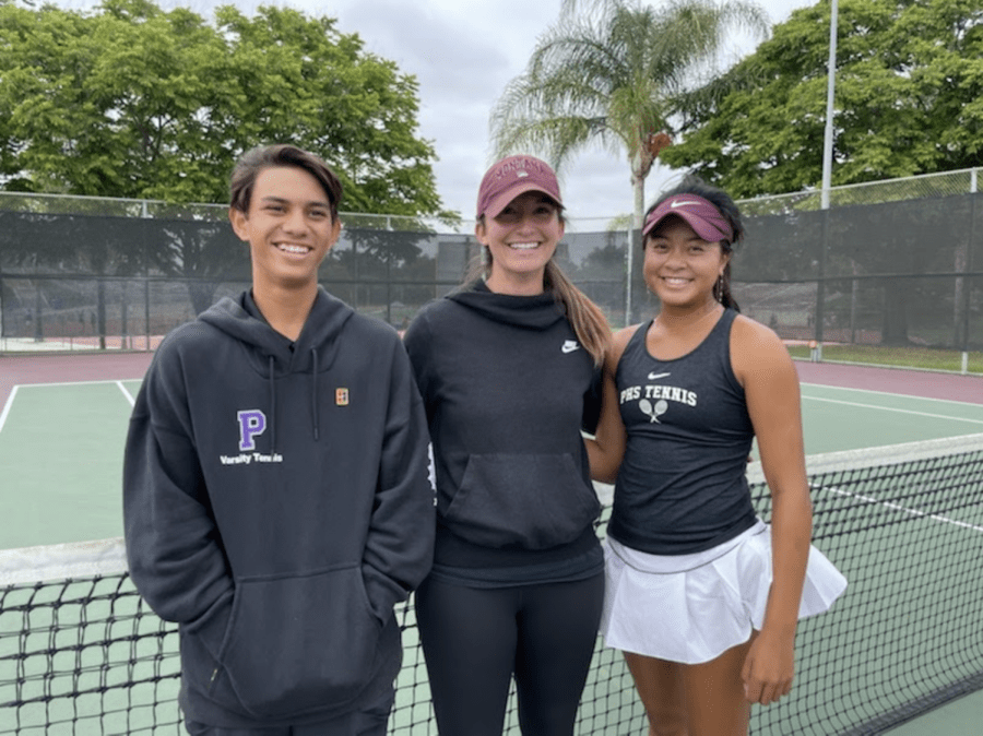 After winning their league titles, junior AJ Moore and sophomore Bella Chhiv posed in front of the net at Heritage Park with their head coach, Natasha Schottland. While league finals are typically held over the span of two days, Moore and Chhiv played on a compressed schedule, winning in their respective brackets on May 10.