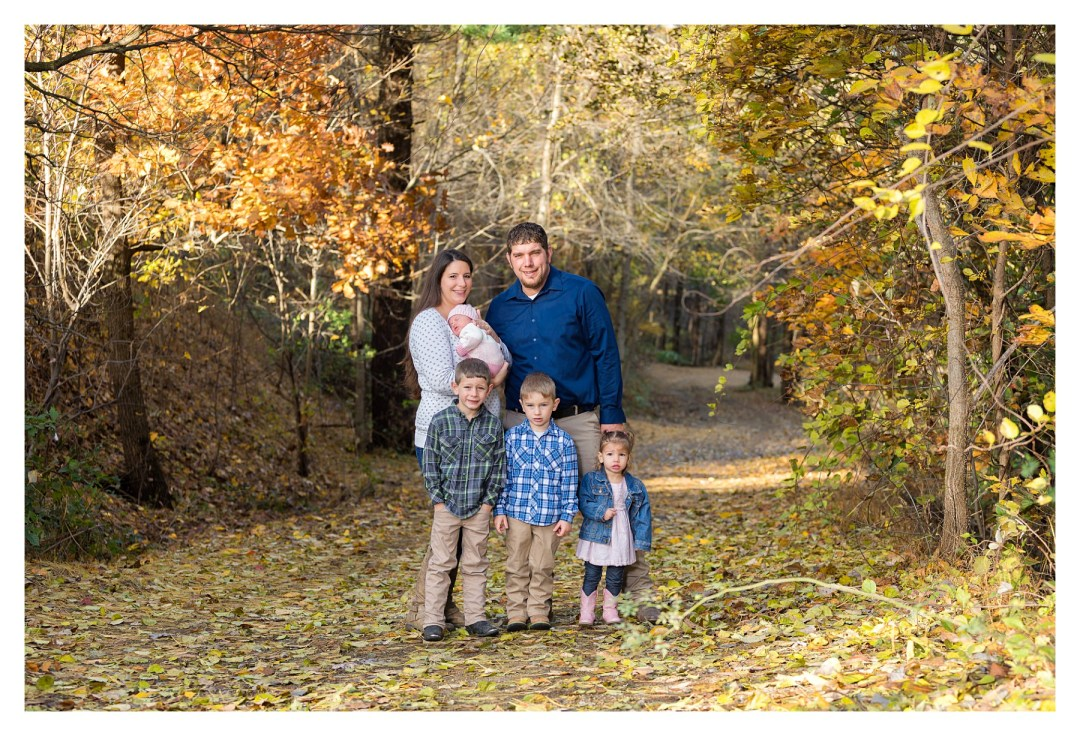 family photo outdoors with newborn in fall