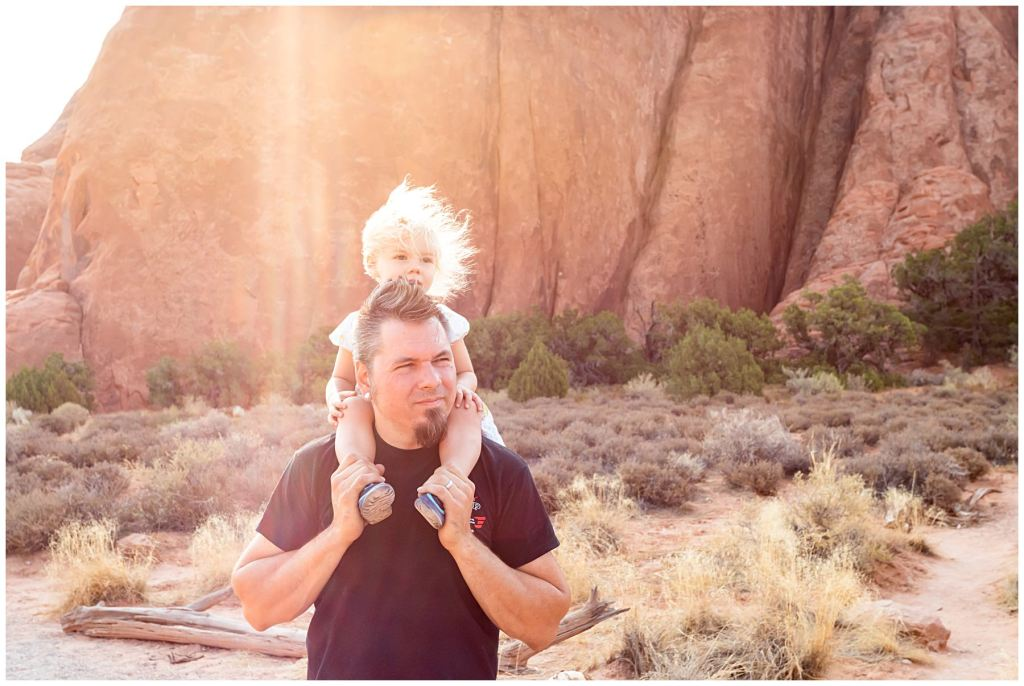 dad with daughter at arches national park