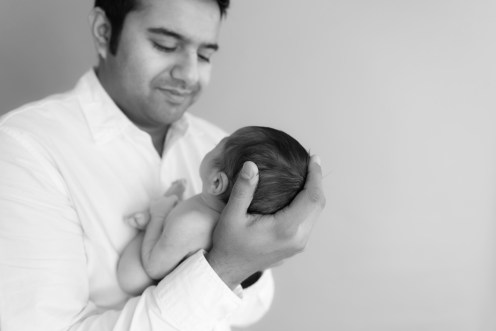 baby in dads hands