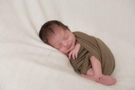 baby boy smiles