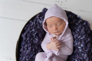 baby girl in purple hooded wrap