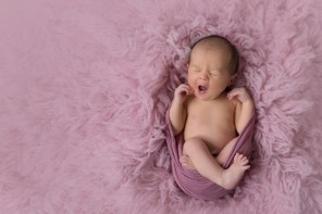 baby girl in dusty rose big yawn