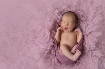 baby girl in dusty rose big yawn
