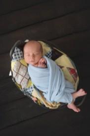 baby boy on quilt