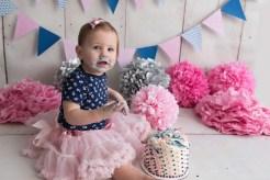 birthday girl loving her cake