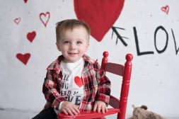 valentines day mini boy in red chair