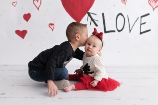 valentines day mini brother kissing sister