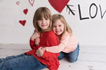 valentines day mini sisters hug