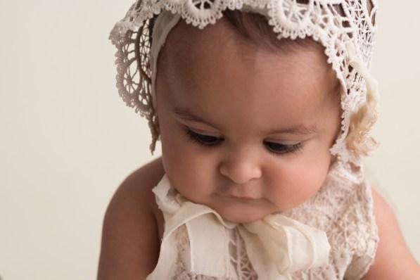 eyelash closeup baby girl in bonnet
