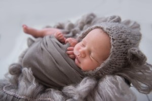 baby with bear bonnet gray