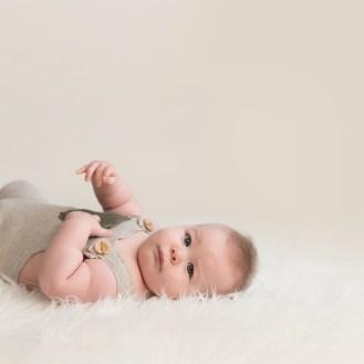 baby boy on soft fluffy rug