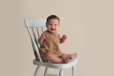 vintage baby sitting on mint chair