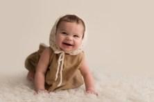 baby girl crawling in bonnet