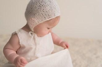 baby looking at vintage dress