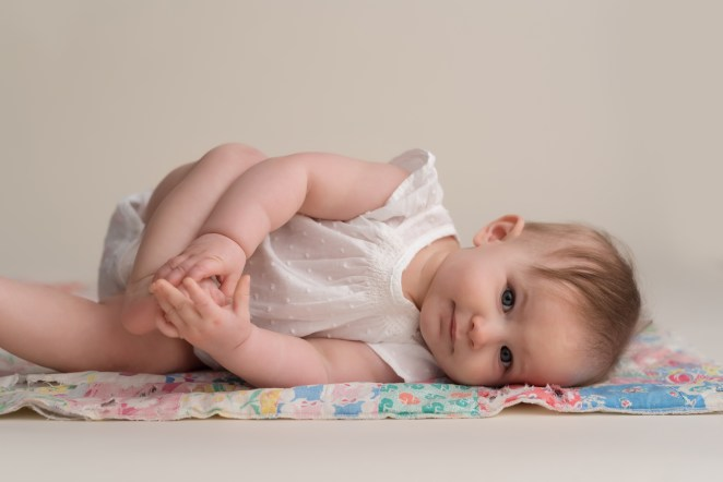 baby playing with feet
