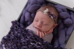 baby girl in purple layers