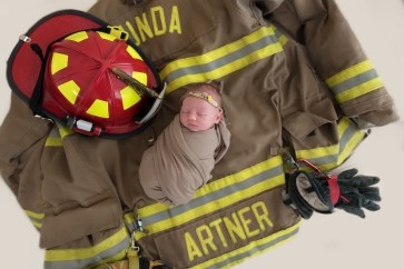baby in firefighter jacket
