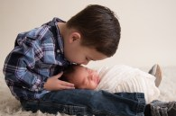 big brother kiss new baby
