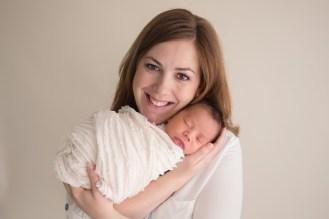 mom holding new baby