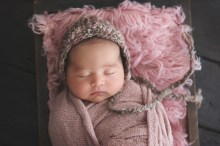 baby girl with in dusty rose