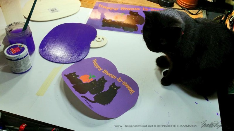 Mimi checks my print and paint as I work on the Pumpkin Panels.