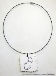 """Back to Front"" pendant, 1.5"" x 1.5"" irregular on wire cord."