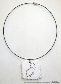 """""""Back to Front"""" pendant, 1.5"""" x 1.5"""" irregular on wire cord."""