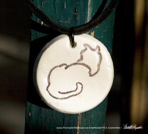 """""""Back to Front"""" pendant, 1"""" x 1"""" round on flocked cord."""