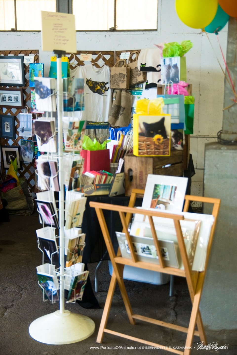 Greeting cards and the print rack at the entrance.