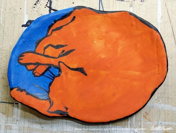 "Orange and blue with black, ""The Big Nap"" decorative dish."