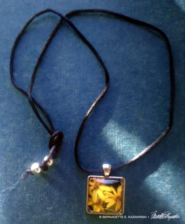 Three Sunflowers square cabochon with cord and beads.