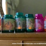 Upcycled glass jar votives in summery colors.