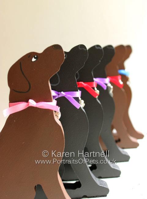 Sitting Labradors, chocolate and black