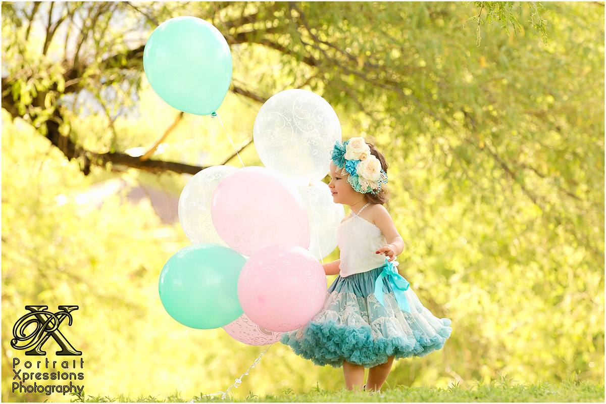 toddler girl with balloons