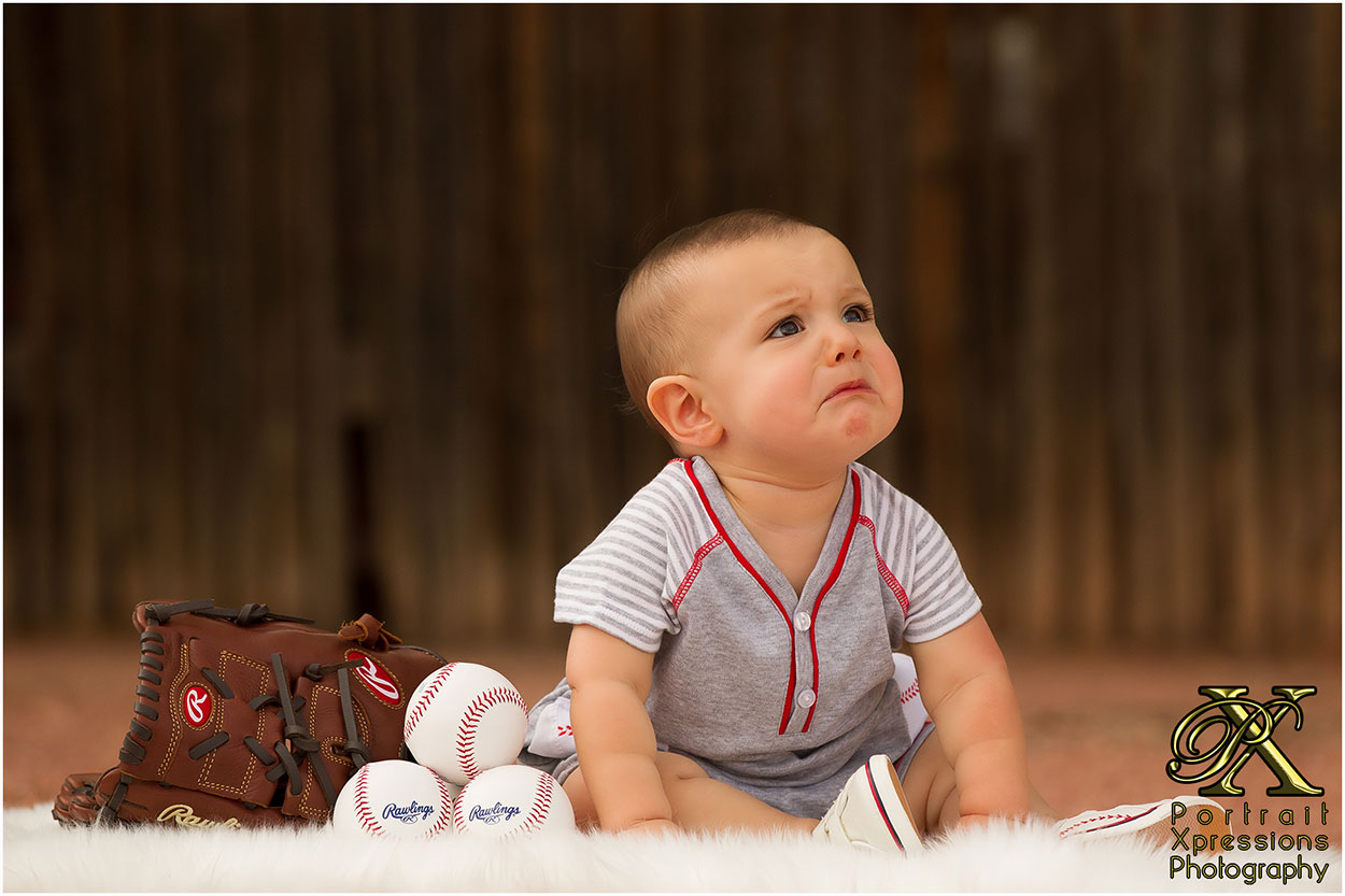 baby crying with baseballs