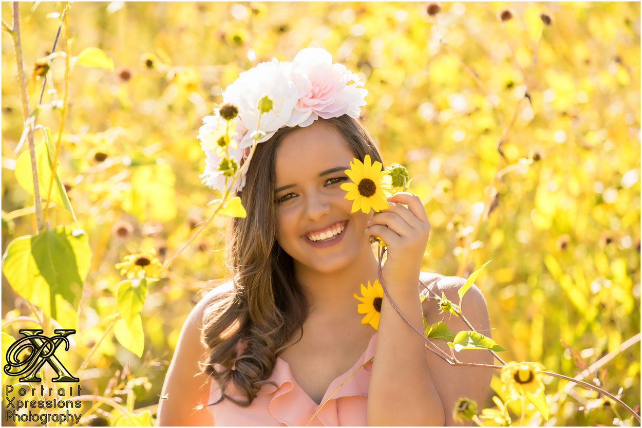 senior with sunflowers