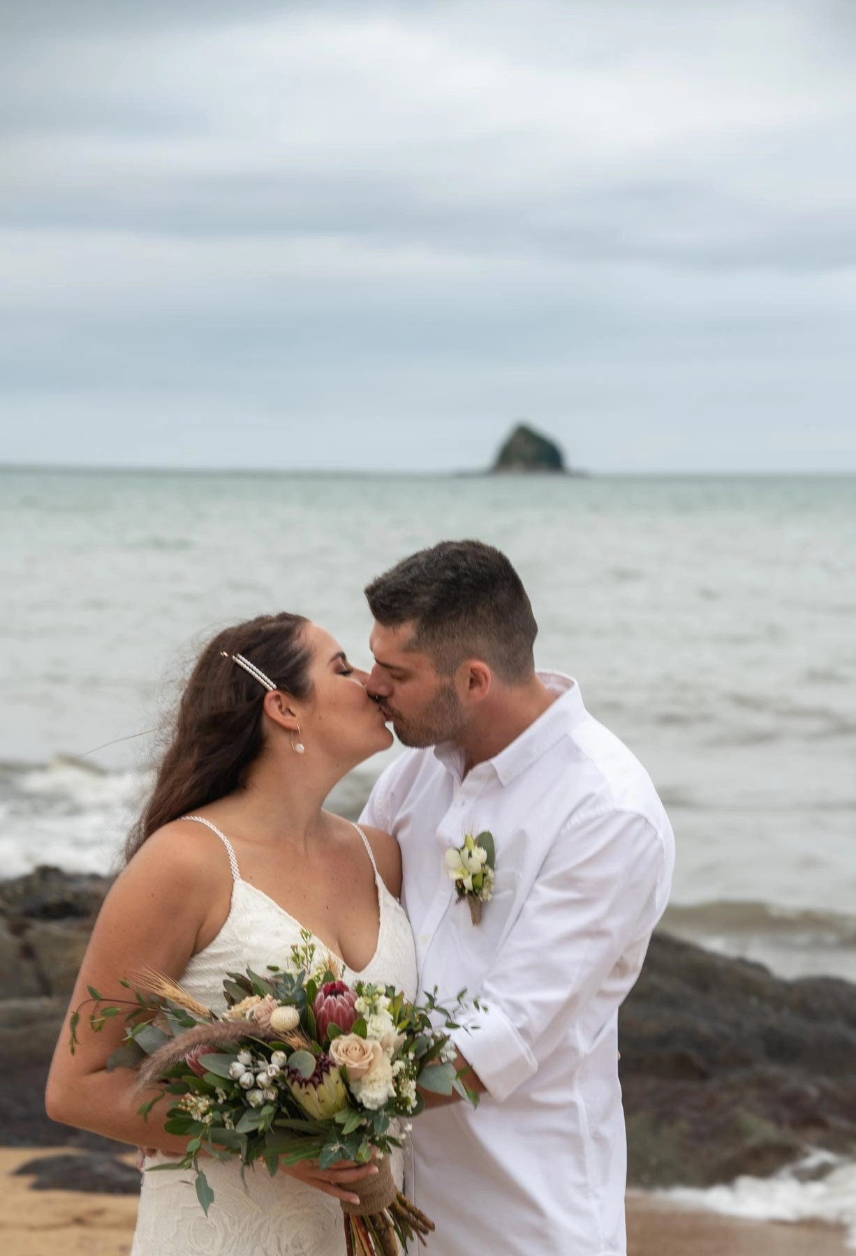 Bridal portrait on palm cove beach with flowers