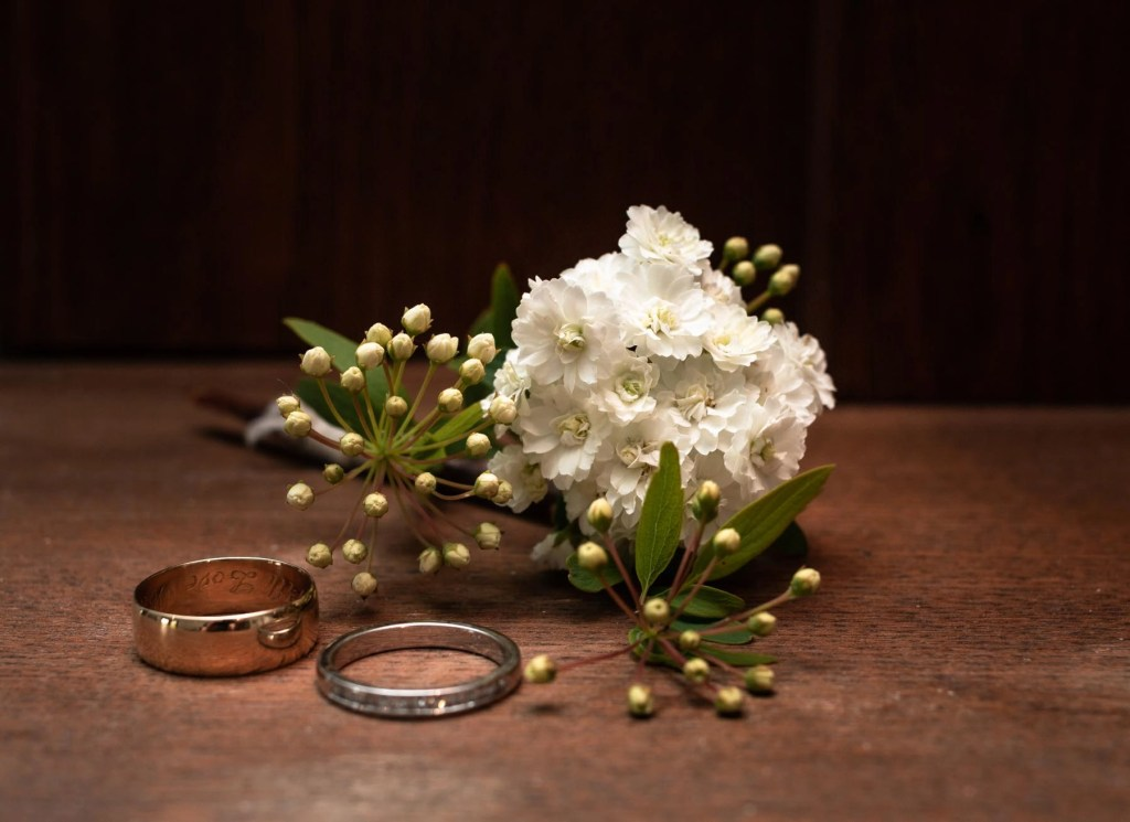 Detail photograph of rings and flowers