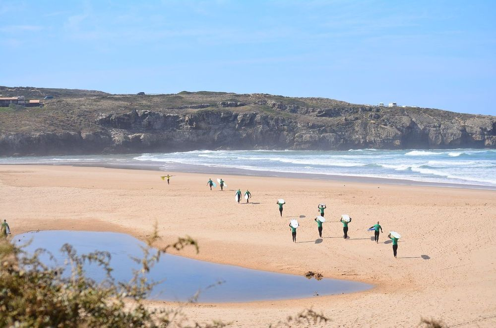 Surf school in Odeceixe beach is going to surf in the waves of the Atlantic ocean in Portugal