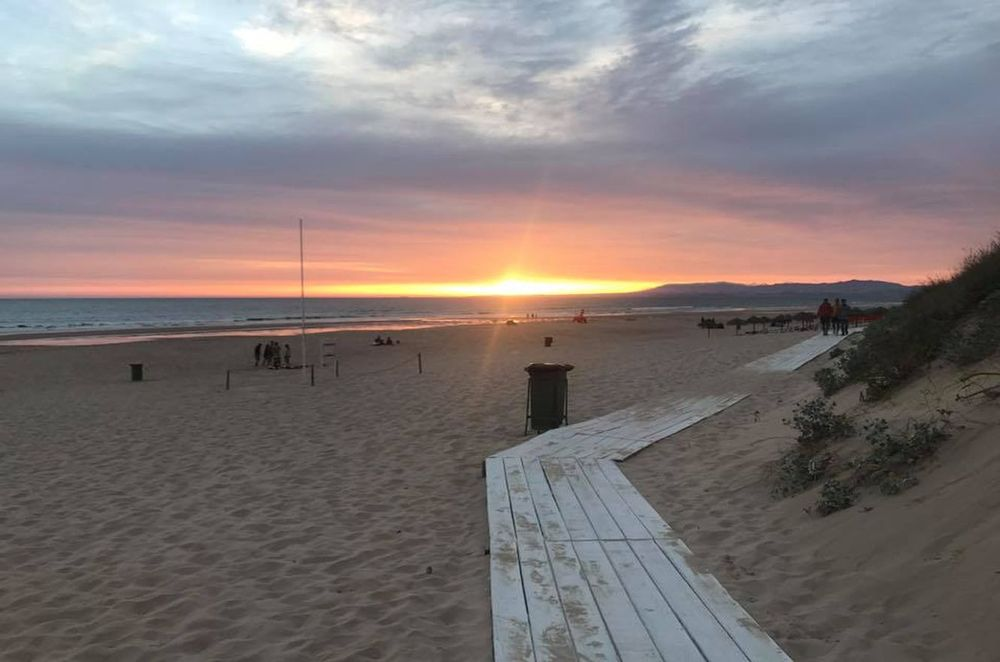 Sunset and ocean at the beach of the Costa da Caparica Portugal