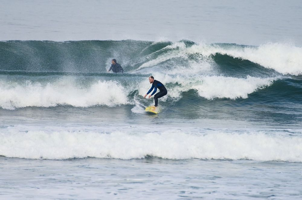 Two people surfing in Ericeira Portugal