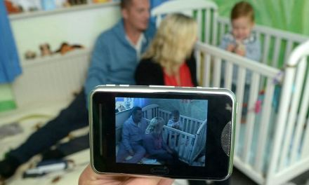 Big Mother: Parents monitor their toddler via CCTV cameras in his bedroom as he suffers up to 16 seizures a day