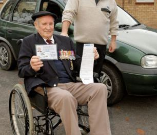 War hero, 90, slapped with a parking ticket during Remembrance Day service – because his blue badge was UPSIDE DOWN