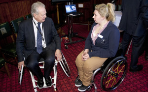 Eric Ollerenshaw MP signs Ottobock's Access to Prosthetics campaign pledge at an exhibition at the House of Commons.