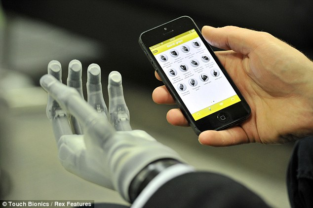 Britain's first bionic boy: Patrick, 16, overjoyed as he gets robotic hand so advanced it can be controlled via smartphone app